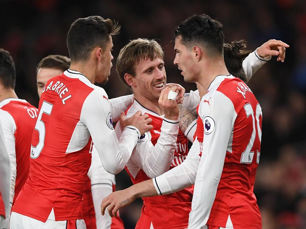 Arsenal's players congratulated Monreal on his deflected strike (Getty)
