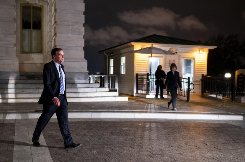 UNITED STATES - MARCH 25: Sen. Mark Warner, D-Va., and Sen. Tina Smith, D-Minn., leave the Capitol after voting on the Coronavirus Aid, Relief, and Economic Security Act in the Capitol on Wednesday night, March 25, 2020. (Photo By Bill Clark/CQ-Roll Call, Inc via Getty Images)
