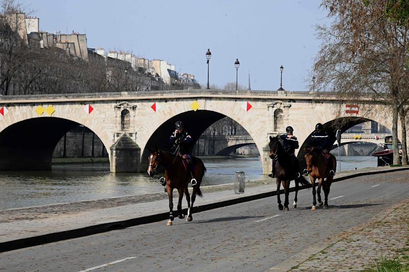 Image: Mounted policemen patroling along the banks of the Seine river, on the fourth day of a strict lockdown in France aimed at curbing the spread of COVID-19 caused by the novel coronavirus (Bertrand Guay / AFP - Getty Images)