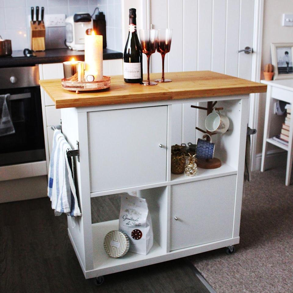 """<p>It sure doesn't look like a bookshelf anymore and I'm obsessed. Inexpensive, easy to DIY, <em>and</em> functional? Count me in.</p><p>See more at <a href=""""http://www.jenloumeredith.com/2017/01/ikea-kallax-kitchen-island-hack.html"""" rel=""""nofollow noopener"""" target=""""_blank"""" data-ylk=""""slk:Jen Lou Meredith"""" class=""""link rapid-noclick-resp"""">Jen Lou Meredith</a>.</p><p><a class=""""link rapid-noclick-resp"""" href=""""https://go.redirectingat.com?id=74968X1596630&url=https%3A%2F%2Fwww.ikea.com%2Fus%2Fen%2Fcatalog%2Fproducts%2F20278167%2F&sref=https%3A%2F%2Fwww.bestproducts.com%2Fhome%2Fg29514474%2Fbest-ikea-hacks%2F"""" rel=""""nofollow noopener"""" target=""""_blank"""" data-ylk=""""slk:BUY NOW"""">BUY NOW</a> <strong><em>KALLAX door inserts, $17, ikea.com</em></strong></p><p><strong><em><a class=""""link rapid-noclick-resp"""" href=""""https://go.redirectingat.com?id=74968X1596630&url=https%3A%2F%2Fwww.ikea.com%2Fus%2Fen%2Fcatalog%2Fproducts%2F96671300%2F&sref=https%3A%2F%2Fwww.bestproducts.com%2Fhome%2Fg29514474%2Fbest-ikea-hacks%2F"""" rel=""""nofollow noopener"""" target=""""_blank"""" data-ylk=""""slk:BUY NOW"""">BUY NOW</a> <strong><em>RILL castor, $10</em></strong>, ikea.com<br></em></strong></p><p><strong><em><strong><em><a class=""""link rapid-noclick-resp"""" href=""""https://go.redirectingat.com?id=74968X1596630&url=https%3A%2F%2Fwww.ikea.com%2Fus%2Fen%2Fcatalog%2Fproducts%2F96671300%2F&sref=https%3A%2F%2Fwww.bestproducts.com%2Fhome%2Fg29514474%2Fbest-ikea-hacks%2F"""" rel=""""nofollow noopener"""" target=""""_blank"""" data-ylk=""""slk:BUY NOW"""">BUY NOW</a> <strong><em>LÄMPLIG chopping board, $10</em></strong></em></strong>, ikea.com<br></em></strong></p>"""