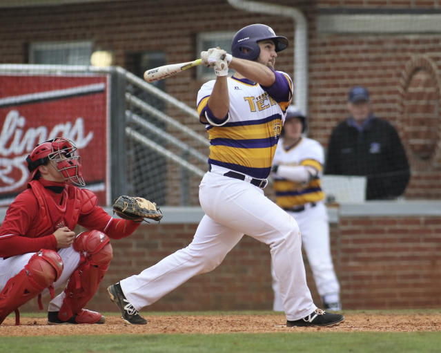 In this April 8, 2018, photo, Tennessee Tech first baseman Chase Chambers plays against Jacksonville State in an NCAA college baseball game in Cookeville, Tenn. Tennessee Tech of the Ohio Valley Conference has won 26 consecutive games by relying on the nation's most potent lineup. (Tony Marable, Tennessee Tech Athletic Department via AP)