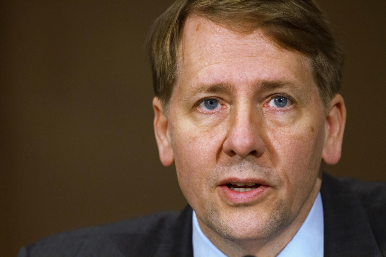 <p> FILE - In this Nov. 12, 2013, file photo, Consumer Financial Protection Bureau Director Richard Cordray testifies before a Senate Committee on Banking hearing on Capitol Hill in Washington. Federal appeals judges are divided as they hear arguments over whether the president should be able to more easily fire the head of the government's consumer finance watchdog agency. The U.S. Court of Appeals for the District of Columbia, in a rare hearing by all its judges, took up the politically charged case involving the CFPB and the power of its director, Cordray. (AP Photo/Jacquelyn Martin, File)
