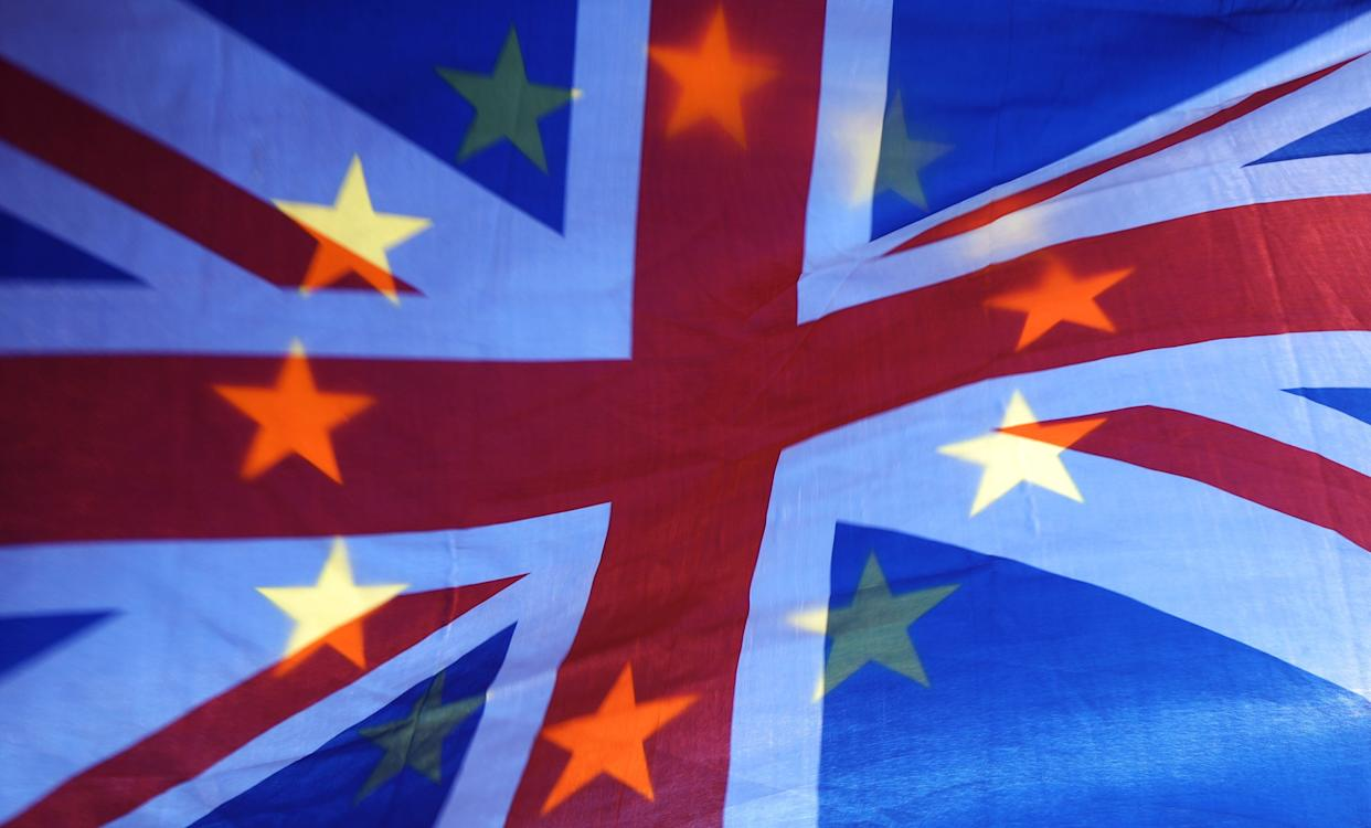 File photo dated 23/04/19 of an EU and Union flag held aloft in Westminster, London. The UK will elect 73 MEPs on May 23, but they could only serve for a few months instead of the usual five years.