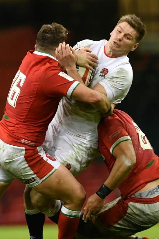 Crunch: Owen Farrell is tackled by Elliot Dee and Taulupe Faletau
