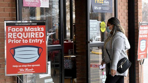 PHOTO: A mask mandate remains in effect as shoppers enter a store in Plano, Texas, March 9, 2021.  (Ian Halperin/UPI via Shutterstock)