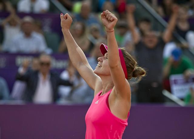 Romania' Simona Halep celebrates after defeating Italy's Roberta Vinci in the singles final match of a WTA Bucharest Open women's tennis tournament in Bucharest, Romania, Sunday, July 13, 2014.(AP Photo/Vadim Ghirda)