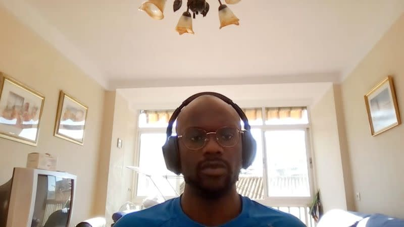 A screengrab dated June 2, 2021 shows a user during a Google Meet video call appearing brighter because of an upcoming light adjustments feature that uses artificial intelligence