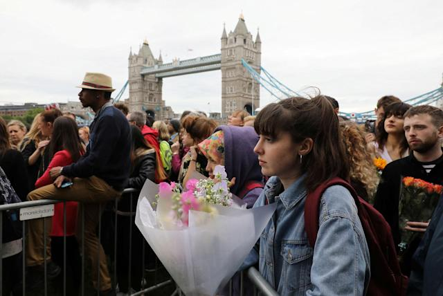 <p>People attend a vigil to remember the victims of the attack on London Bridge and Borough Market, at Potters Field Park, in central London, Britain, June 5, 2017. (Photo: Marko Djurica/Reuters) </p>