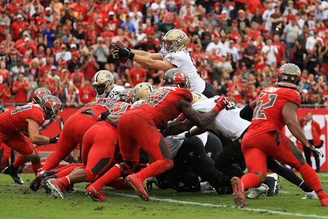 <p>Drew Brees #9 of the New Orleans Saints scores a touchdown during the fourth quarter against the Tampa Bay Buccaneers at Raymond James Stadium on December 09, 2018 in Tampa, Florida. (Photo by Mike Ehrmann/Getty Images) </p>