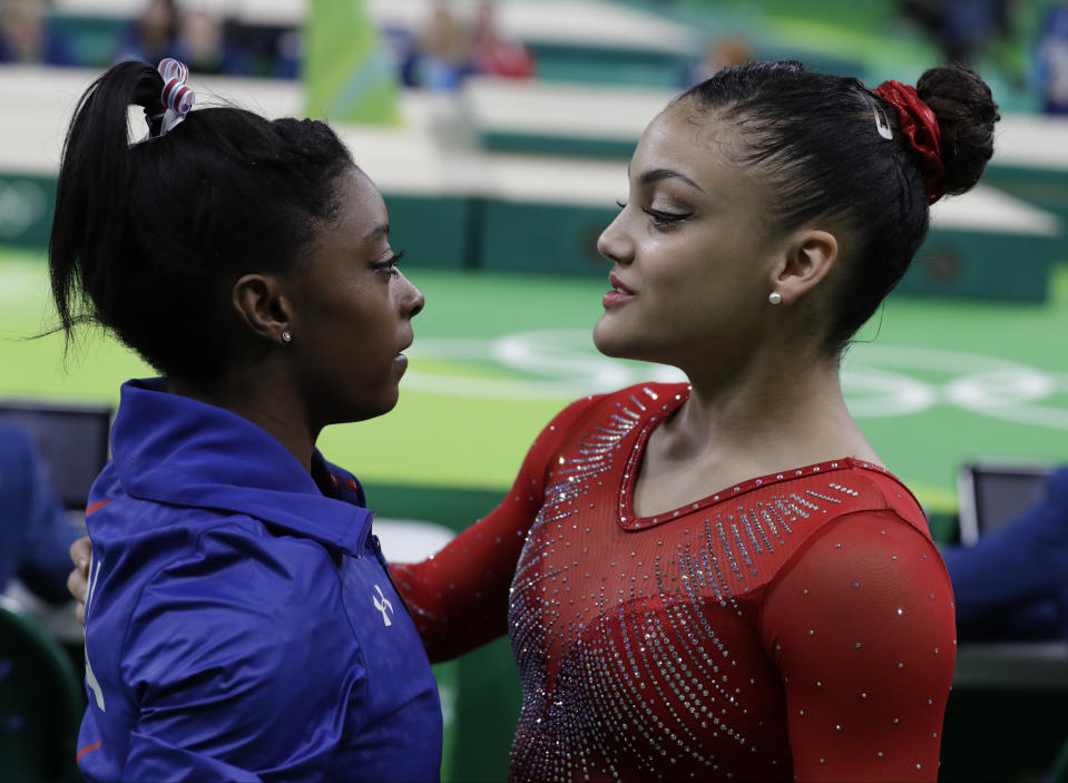 United States' Simone Biles is comforted by compatriot Lauren Hernandez after her balance beam routine during the artistic gymnastics women's apparatus final at the 2016 Summer Olympics in Rio de Janeiro, Brazil, Monday, Aug. 15, 2016. (AP Photo/Rebecca Blackwell)