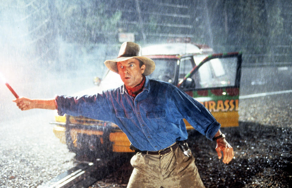 Sam Neill stands out in the rain in a scene from the film 'Jurassic Park', 1993. (Photo by Universal/Getty Images)