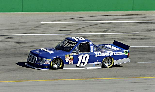 NASCAR driver Brad Keselowski puts his NASCAR Truck Series vehicle through a practice lap at Kentucky Speedway in Sparta, Ky., Thursday morning, June 26, 2014. Keselowski will try to compete in all three NASCAR races this weekend in Kentucky. (AP Photo/Garry Jones)
