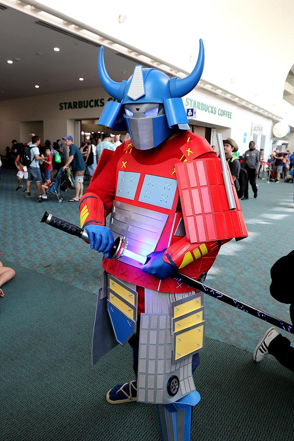 <p>Cosplayer dressed as Samurai Optimus Prime from <i>Transformers</i> at Comic-Con International on July 21, 2018, in San Diego. (Photo: Angela Kim/Yahoo Entertainment) </p>