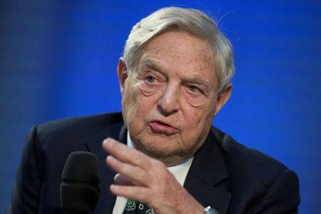 FILE PHOTO: Soros Fund Management Chairman George Soros speaks during a panel discussion at the Nicolas Berggruen Conference in Berlin, October 30, 2012. REUTERS/Thomas Peter/File Photo