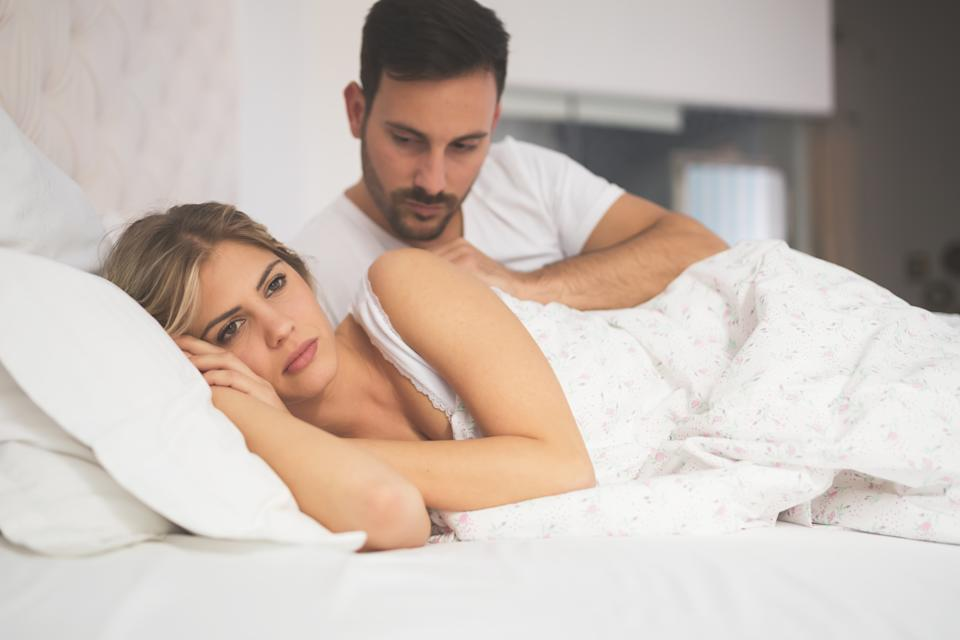 Relationship crisis in bed with feeling of guilt