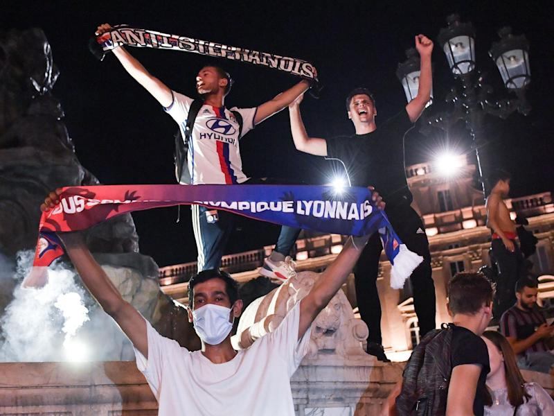 Lyon fans celebrate victory over Juventus in the streets of Lyon: AFP
