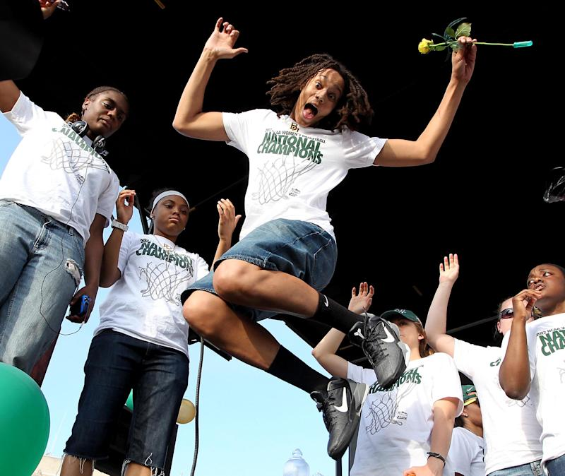 Baylor's Brittney Griner leaps in the air in front of her teammmates after the city of Waco honored the 2012 NCAA women's Division I basketball champions with a parade,  Monday, April 16, 2012, in Waco, Texas. (AP Photo/Waco Tribune Herald, Jerry Larson)
