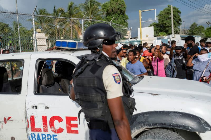 FILE PHOTO: Haitian National Policemen guard the entrance to the U.S. Embassy as people gather to ask for asylum following the assassination of President Jovenel Moise