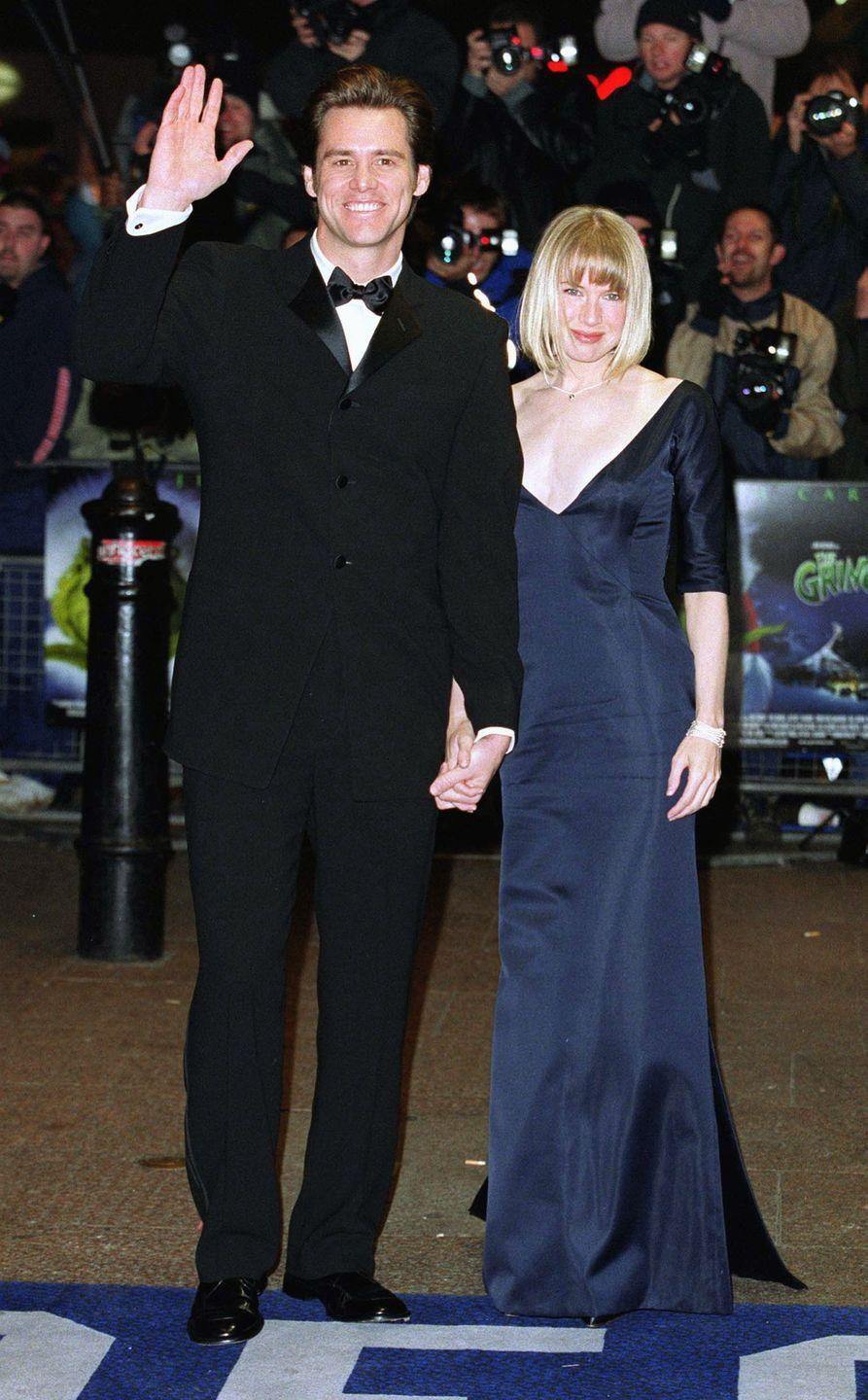 <p>Jim Carrey and Renée Zellweger looked polished in a classic tux and navy gown as they made their way to the reception line to meet the Queen at Carrey's film premiere for <em>The Grinch</em><em>.</em></p>