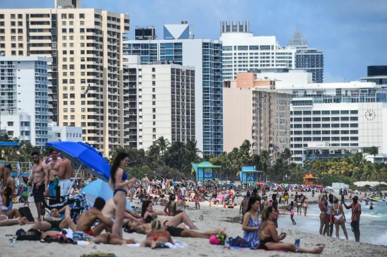 "The ""Spring Break"" held by US colleges and universities is peak season for Miami Beach, and tourists still flocked to the sand ignoring the new coronavirus pandemic (AFP Photo/CHANDAN KHANNA)"