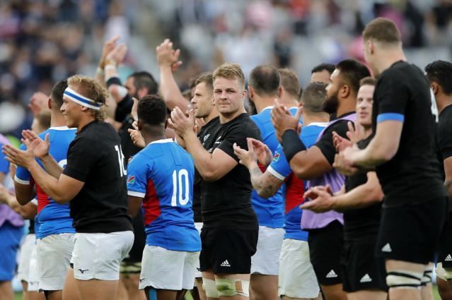 Players thank the crowd following the Rugby World Cup Pool B game at Tokyo Stadium between New Zealand and Namibia in Tokyo, Japan, Sunday, Oct. 6, 2019. The All Blacks defeated Namibia 71-9. (AP Photo/Christophe Ena)