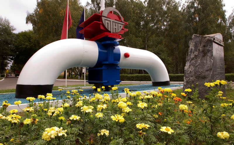 FILE PHOTO: Model of a pipeline is seen at the main entrance to the Gomel Transneft oil pumping station near Mozyr