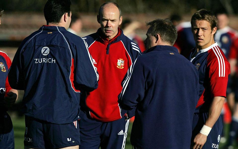 Clive Woodward speaks with Jonny Wilkinson and Eddie O'Sullivan - PA