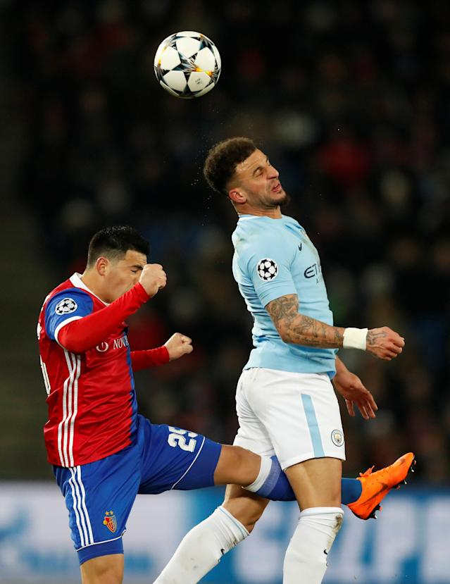 Soccer Football - Champions League - Basel vs Manchester City - St. Jakob-Park, Basel, Switzerland - February 13, 2018 Manchester City's Kyle Walker in action with Basel's Blas Riveros Action Images via Reuters/Andrew Boyers