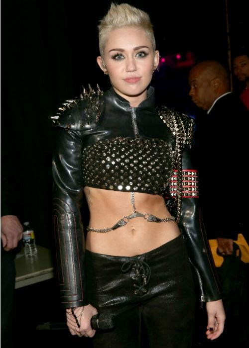<b>Miley Cyrus:</b> From her sweet Hannah Montana days to her I'm-a-woman- hear-me-roar 'phase, Miley Cyrus' dramatic transformation is a tad unsettling, almost in a cry-for-help way. Her early engagement to her mohawk, and the recent side-nip slip at the pre-Grammy party this year, here she is in yet another leather meets punk avatar at the 'VH1 Divas' 2012 at The Shrine Auditorium on December 16, 2012 in Los Angeles, California where she performed.