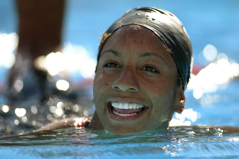 Maritza Correia smiles after swimming the 50 meter freestyle final during the US Swimming Olympic Team Trials on July 14, 2004.