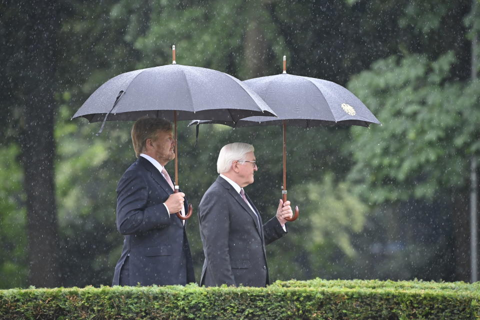 German president Frank-Walter Steinmeier, right, welcomes King Willem-Alexander of the Netherlands at the Bellevue palace ion Berlin, Germany, Monday, July 5, 2021. The Royals arrived in Germany for a three-day visit that was delayed from last year because of the coronavirus pandemic. (Bernd Von Jutrczenka/dpa via AP)