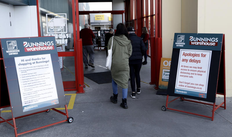Customers enter a hardware store in Christchurch, New Zealand, Thursday, May 14, 2020. New Zealand lifted most of its remaining lockdown restrictions from midnight Wednesday as the country prepares for a new normal. Malls, retail stores and restaurants are all reopening Thursday in the South Pacific nation of 5 million, and many people are returning to their workplaces. (AP Photo/Mark Baker)