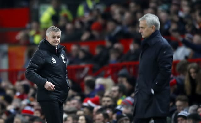 Ole Gunnar Solskjaer looks towards Spurs manager Jose Mourinho (Martin Rickett/PA)