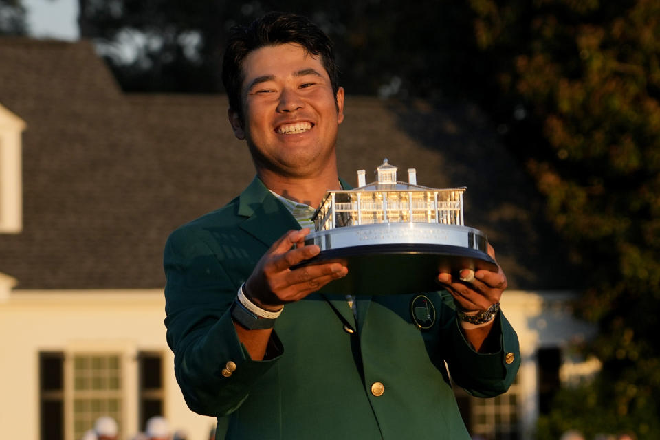 Hideki Matsuyama, of Japan, holds the trophy after winning the Masters golf tournament on Sunday, April 11, 2021, in Augusta, Ga. (AP Photo/David J. Phillip)