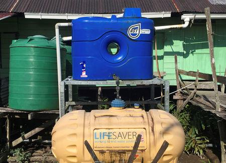 A water tank with a Satu Malaysia (One Malaysia) logo is pictured at Nanga Semah village in Sarawak, Malaysia April 24, 2018. Picture taken April 24, 2018. REUTERS/A. Ananthalakshmi