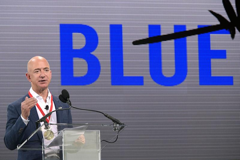 Amazon CEO Jeff Bezos addresses reporters and guests during a news conference unveiling the new Blue Origin rocket at the Cape Canaveral Air Force Station in Cape Canaveral, Fla., Tuesday, Sept. 15, 2015. Bezos announced a $200 million investment to build the rockets and capsules in the state and launch them using the historic Launch Complex 36. (AP Photo/Phelan M. Ebenhack)