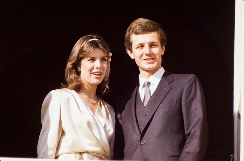 <p>Princess Caroline and her second husband Stefano Casiraghi appeared on the balcony of the Royal Palace after their civil wedding ceremony in December 1983.</p>
