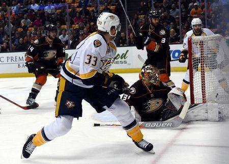 Nashville Predators center Colin Wilson (33) shoots the puck past Anaheim Ducks goalie Frederik Andersen (31) for a goal in the first period in game seven of the first round of the 2016 Stanley Cup Playoffs at Honda Center. Mandatory Credit: Kirby Lee-USA TODAY Sports