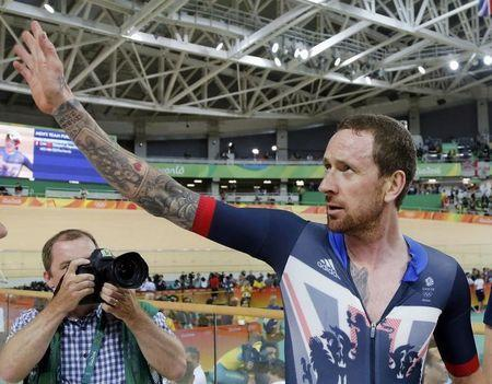 2016 Rio Olympics - Cycling Track - Final - Men's Team Pursuit Final Gold Race - Rio Olympic Velodrome - Rio de Janeiro, Brazil - 12/08/2016. Bradley Wiggins (GBR) of Britain celebrates winning the race and setting a new world record. REUTERS/Eric Gaillard