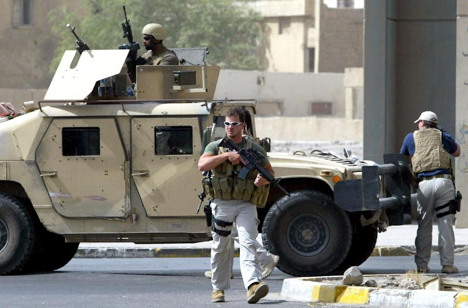 Contractors of the US private security firm Blackwater secure the site of a roadside bomb attack in central Baghdad, July 5, 2005 (AFP Photo/Ahmad al-Rubaye)