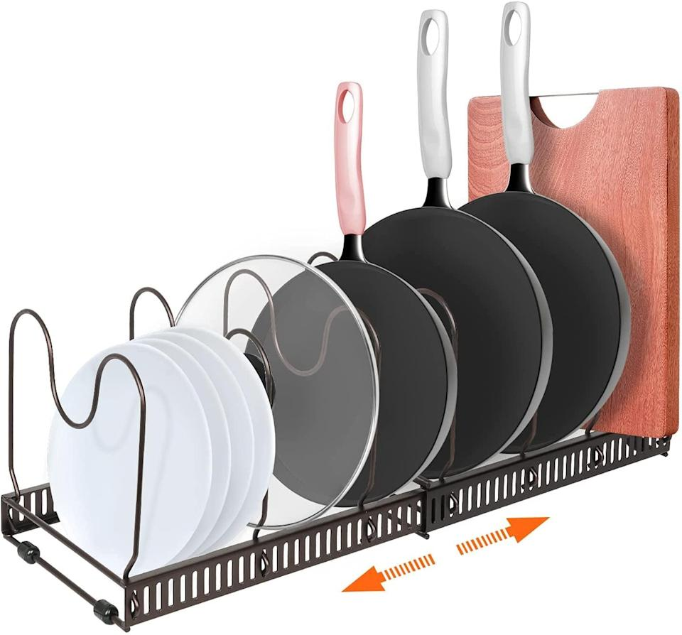 <p>Organize your pots, pans, lids, and more with the <span>Expandable Pot and Pan Rack Organizer</span> ($19). It has seven adjustable compartments that will keep your kitchen clean and organized. </p>