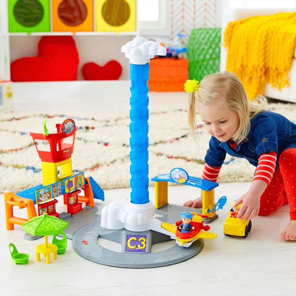 """<p>A trip to the airport has truly never been so fun as with the <span>Little People Spinnin' Sounds Airport</span> ($150) from Fisher-Price. Your budding air traffic controller can take the plane up to the top of the pole, press on the cloud and watch the plane spin around as it """"flies."""" </p>"""