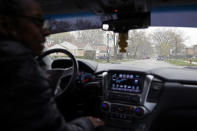 Kimberly Ross-Holmes drives through Evanston fifth ward, where she spent her childhood, Friday, April 23, 2021. The Chicago suburb will become the first to pay reparations in the form of housing grants. She said she is glad that Juneteenth will be a federal holiday, but hopes that the federal government takes up more issues that affect the everyday lives of Black people. (AP Photo/Shafkat Anowar)