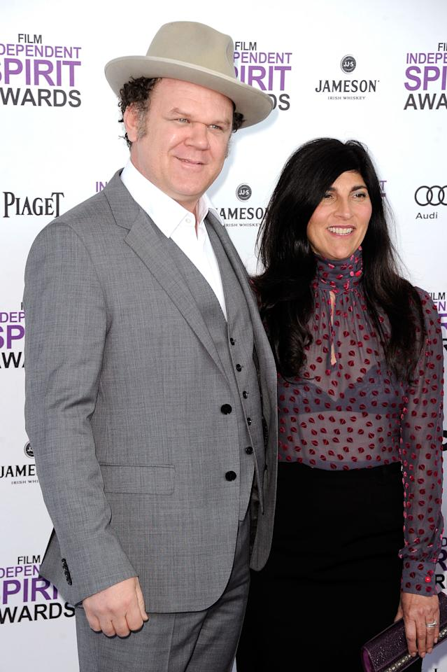SANTA MONICA, CA - FEBRUARY 25:  Actor John C. Reilly (L) and producer Alison Dickey arrive at the 2012 Film Independent Spirit Awards on February 25, 2012 in Santa Monica, California.  (Photo by Frazer Harrison/Getty Images)