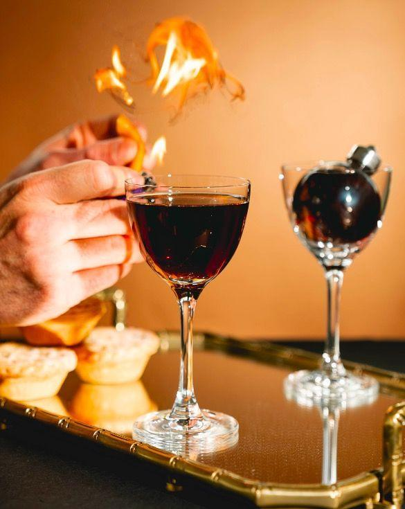 """<p>Make a mince pie vermouth by combining 200ml Sweet Vermouth (Cocchi di Torino), 200ml Dry Vermouth (Dolin Dry) and 100g mince meat mix in a jar. Shake well and immediately strain.</p><p>To make the cocktail, combine 50ml <a href=""""https://www.masterofmalt.com/gin/58-distillery/58-gin-english-berry-gin/"""" rel=""""nofollow noopener"""" target=""""_blank"""" data-ylk=""""slk:58 Gin English Berry"""" class=""""link rapid-noclick-resp"""">58 Gin English Berry</a>, 30ml Mince Pie Vermouth and 5ml sugar syrup. Light an orange peel with a flame and squeeze for the zest – discard the zest at the end.</p>"""
