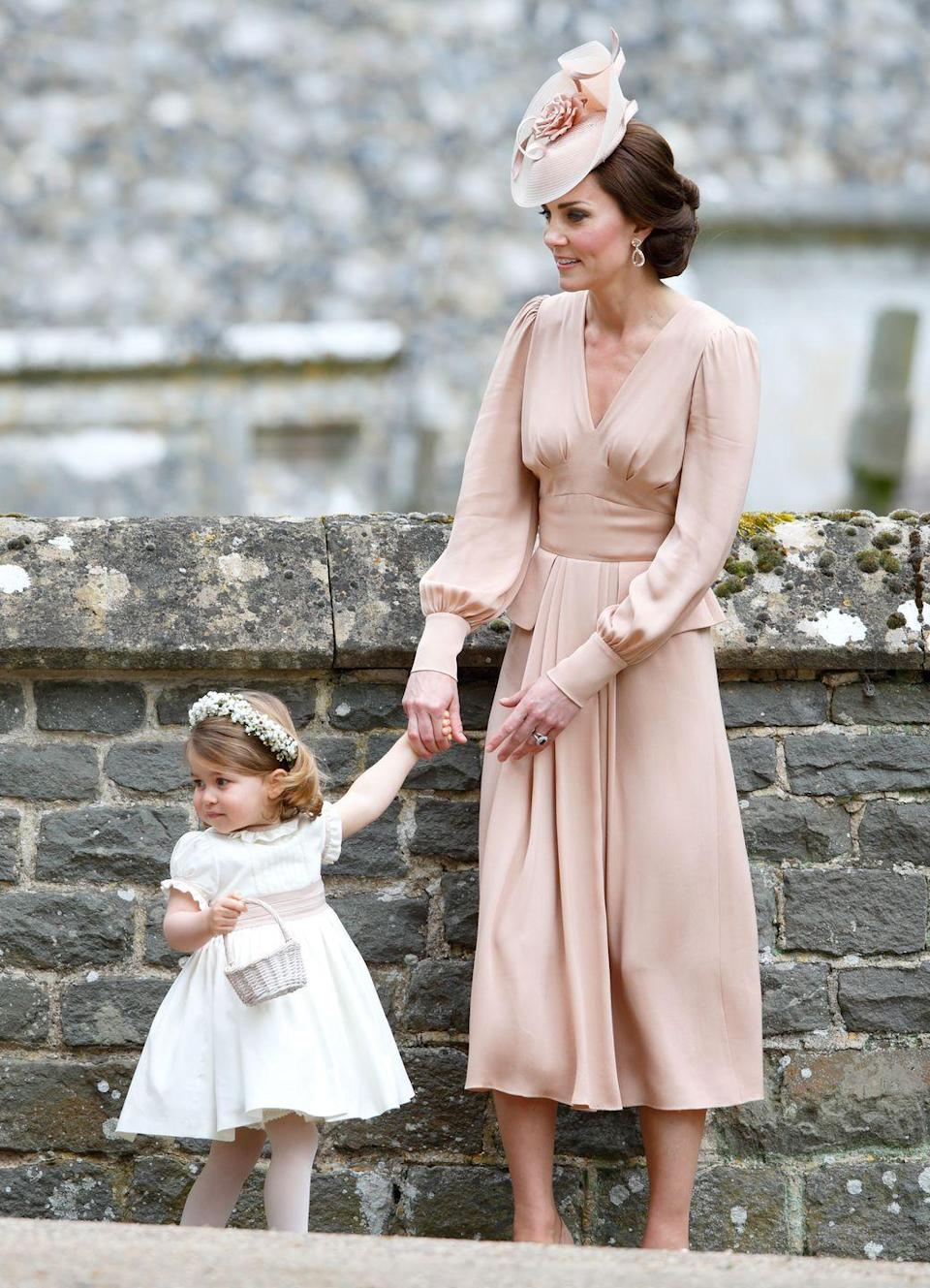 <p>Since Pippa Middleton wore McQueen to Kate's wedding, it seems only fair that the Duchess wore the designer to Pippa's nuptials. Kate paired the elegant dress with a matching fascinator. </p>