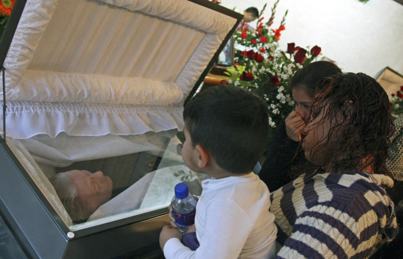 Mourners pay homage to U.S. missionary Wanda Casias during an open casket funeral service held for her and her husband John at the couple's church in the town of El Cercado, about 20 minutes from Monterrey, Mexico, Thursday Feb. 2, 2012. John and Wanda Casias, originally from Amarillo, Texas,  who moved to a remote and violence-plagued area of northern Mexico to run a Baptist church were found slain last Jan. 31 at their ransacked home. (AP Photo/Hans Maximo Musielik)