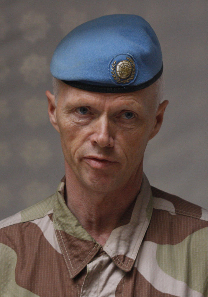 In this picture taken during a UN observer-organized tour, the head of the advance team of UN observers, Maj. Gen. Robert Mood, speaks to journalists during his team's visit to Homs city, central Syria, on Thursday May 3, 2012. Syrian security forces stormed dorms at a northwestern university to break up anti-government protests there, killing at least four students and wounding several others with tear gas and live ammunition, activists and opposition groups said Thursday. (AP Photo/Muzaffar Salman)