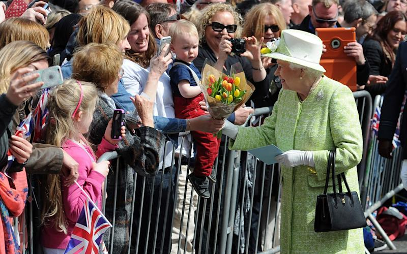 The Queen meets wellwishers near Windsor Castle on her 90th birthday - Credit: PA
