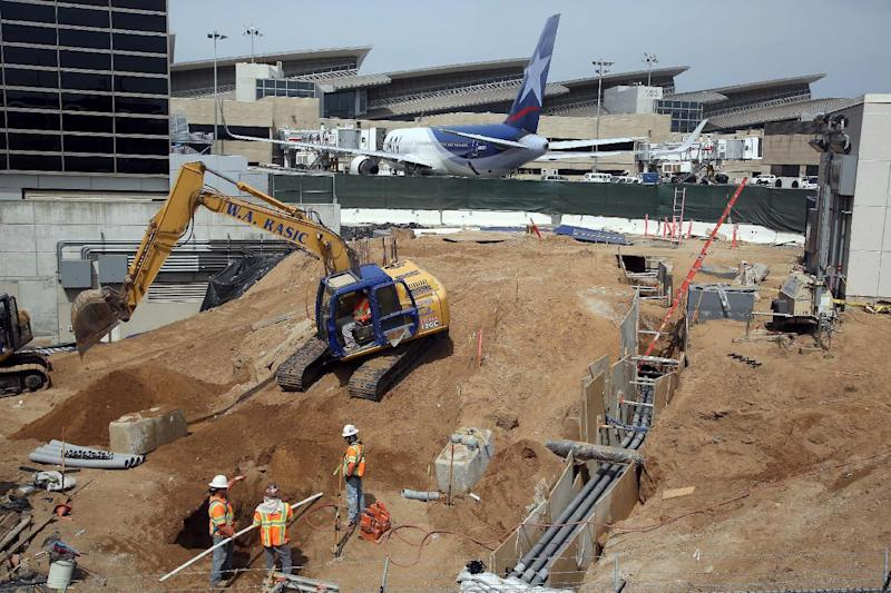 In this Monday, May 5, 2014 photo construction crews dig at Los Angeles International Airport, LAX. An ongoing, multibillion-dollar renovation at the nation's third-busiest airport that has mostly been behind the scenes will soon start affecting passengers in ways large and small. LAX officials began warning the public about the coming inconveniences that will stretch over the next few years and affect traffic around the terminals and passenger movements inside them. (AP Photo/Nick Ut )